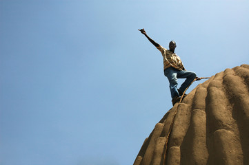 Man on the top of traditional bulding in open-air museum
