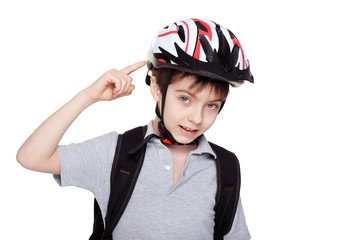 boy cyclist pointing to his helmet
