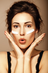 Happy woman with creamy sponge on her face. Skin care, removing