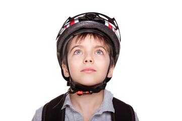 little cyclist in helmet looking up closeup portrait