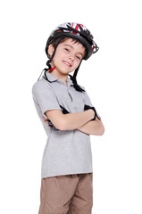 Smiling boy cyclist with crossed hands in a white studio