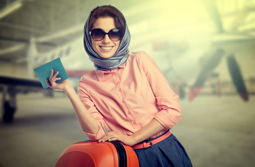 Fashionable woman at the airport on the plane background