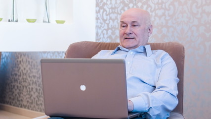 Retired man working with fun