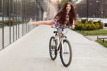Young beautiful woman on a bicycle