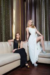 luxury girls in evening dresses in beautiful settings