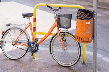 Trash metal orange waste and bicycle