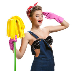 woman wearing pink rubber protective gloves holding mop