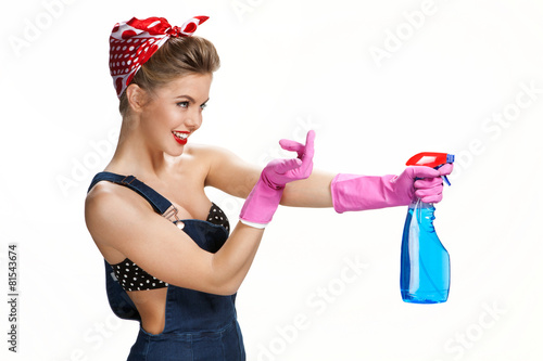 Inviting housewife holding spray bottle