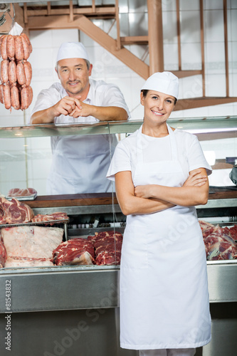 Butchers At Display Cabinet In Butchery - 81543832