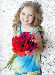 Picture of litlle girl with flowers in hands