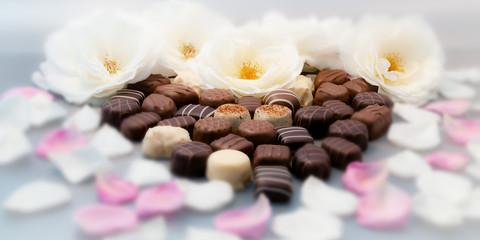 Romantic chocolate truffles white roses heart horizontal