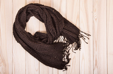 brown scarf on wooden background