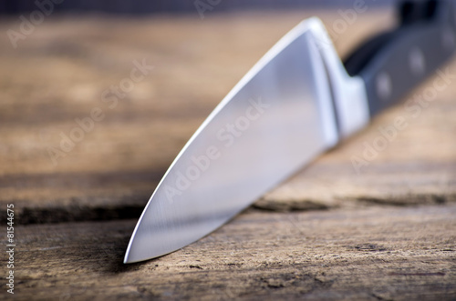 Knife on rustic kitchen table with copy space - 81544675