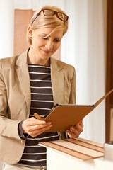 Blonde woman using tablet pc