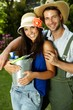 Portrait of attractive young gardening couple