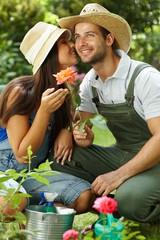 Happy gardening couple kissing