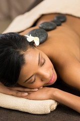Relax with hot stone massage