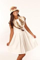 Beautiful girl posing in summer dress