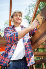 Smiling Construction Worker Standing At Site