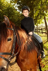 Cute little boy on horseback