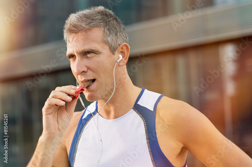 Fitness Man Eating Snack Food - 81545261