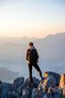 Leinwanddruck Bild - Young photographer on the top of mountain