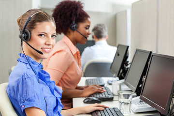 Happy Customer Service Agent Using Computer At Office