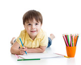 Fototapety Cute child boy drawing with pencils in preschool isolated