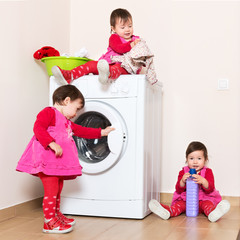 Little child using washing machine