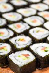 many rolls with salmon close-up