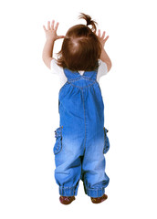 Child stands with hands up, isolated on white. Back view