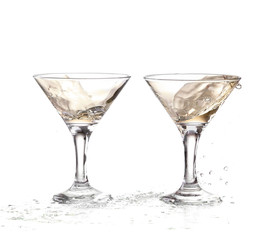 two wine swirling in a goblet martini glass, isolated