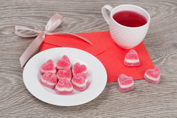 candies in a heart shape and tea
