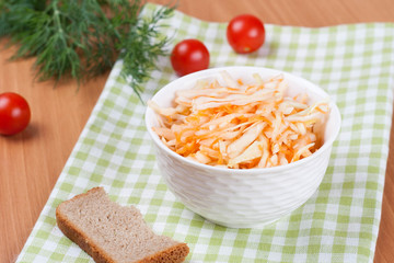salad of cabbage with carrots and green onions in a cup horizont