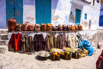 handbags and clothing front of the shop, Chefchaouen, Morocco