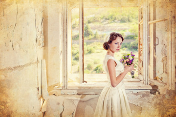 Young woman with bouquet flowers in old room at open window.