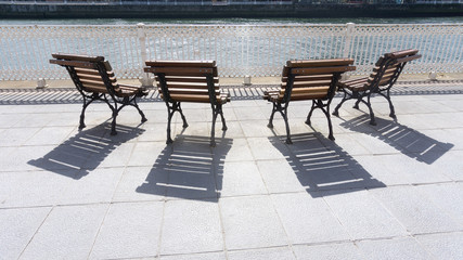 wooden benches and shadows