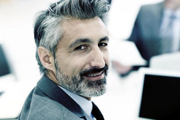 Portrait of mature businessman with grey hair