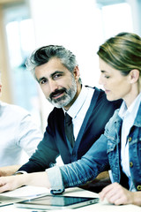 Portrait of businessman in work meeting