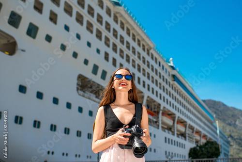Fototapeta Woman tourist near the big cruise liner