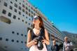 Woman tourist near the big cruise liner - 81549286