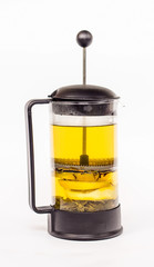 isolated transparent kettle of green tea