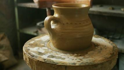 Finished Jug Rotating on Pottery Wheel