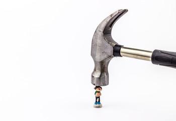 Hammer smashing figurine on white background