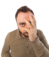 Man with a desperate expression with hand in face.