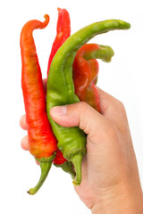 red and green hot pepper in hand
