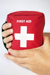 First aid kit with two hands - english tittle