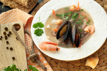 soup with seafood and shrimp on a plate