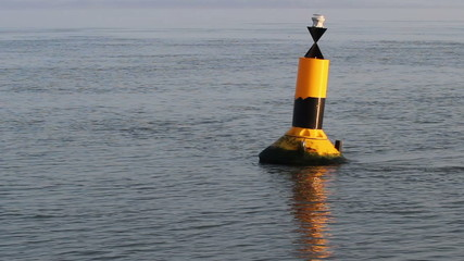 Tide flows against marker buoy