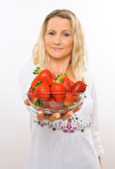 Young housewife, with bowl of strawberries